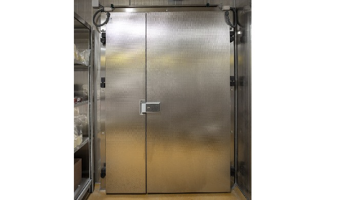 COLD STORE AND FREEZER ROOM DOORS Door System's cold store and freezer room doors are made in a simp...