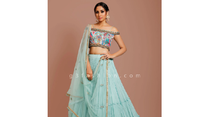 Get compliments from onlookers in wedding functions by adorning this sea green georgette lehenga cho...
