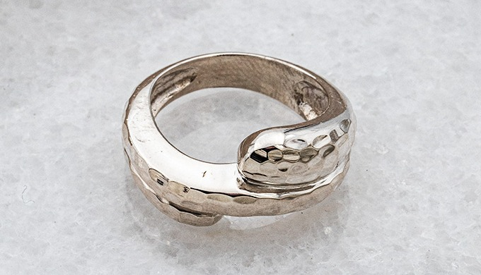 Handmade ring, made of 925 silver in white color with forged design.