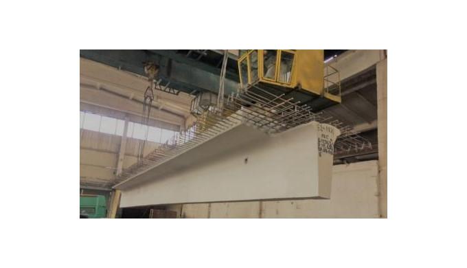 FEC SA produce grinzi din beton armat secțiune T cu lungimea de 12, 15, 18 m utilizate la construcți...