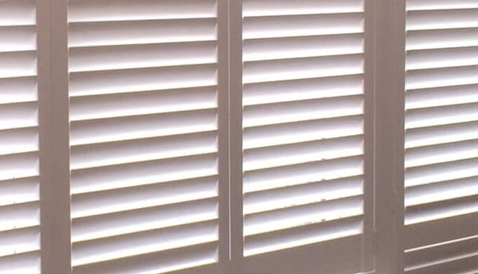 Café style shutters go halfway up the window, leaving the top of your window clear for the sun to ea...