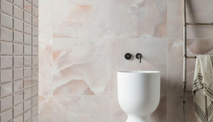 Add a touch of luxury to your interiors with our Onyx Nouveau Opal Gloss Porcelain Tile. This tile f...