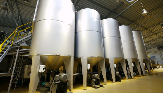 After milling and heating, fruit pulp is transported to pulp tanks where it will be taken for pressi...