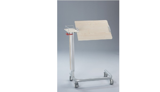 Over bed Table made of wooden tray with tilting and metal barriers in order to prevent items from fa...