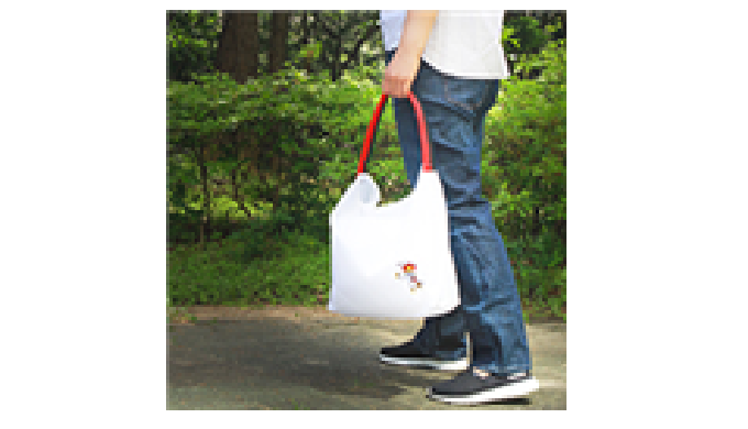 The rolled-up Taekwondo belt transforms into a Ecobag when the belt is unfolded - The Taekwondo Ecob...