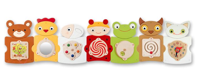 Pomůcky na rozvoj smyslového vnímání a jemné motoriky. Nástěnné hrací prvky do dětského interiéru.