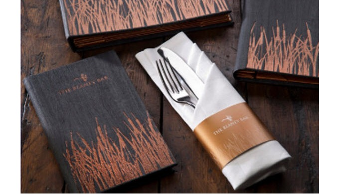 Black wooden menu with laser engraved logo for Mango Tree in Harrods. Cocktail size which takes half...