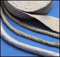 Textilier, vävar, rep, muffar och andra tätningar, packningar eller skydd. Finns i glasfiber, silika...
